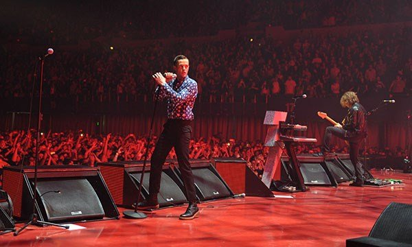 "Brandon Flowers of The Killers performs on the ""Battle Born"" tour in Los Angeles on May 2, 2013. (Source: AP)"