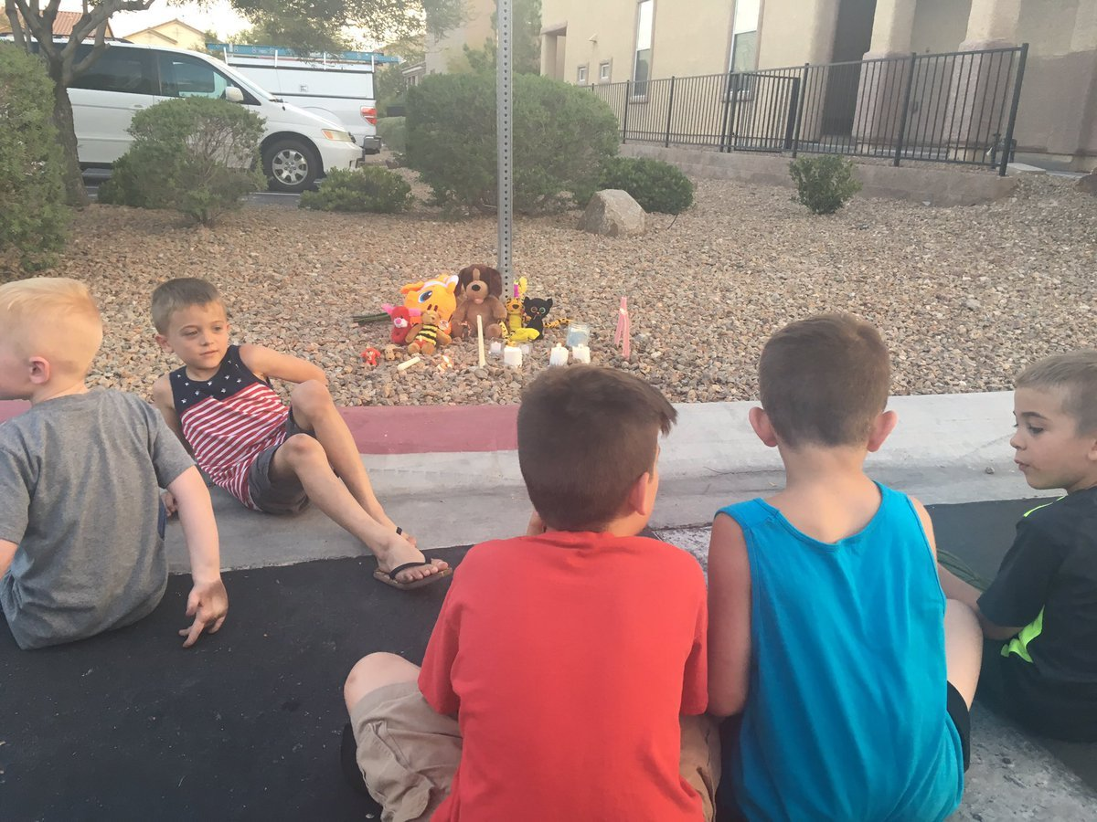 A vigil was held Thursday after a four-year-old boy died, his mother suffered critical stab wounds, and the suspect, his father, died after a murder-suicide in southwest Las Vegas Wednesday.