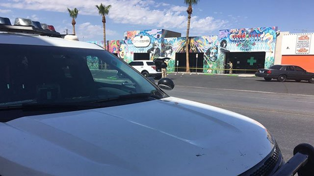 Officers shown with crime tape marking a burglary scene at a marijuana dispensary in central Las Vegas on July 29, 2017. (Cherney Amhara/FOX5)