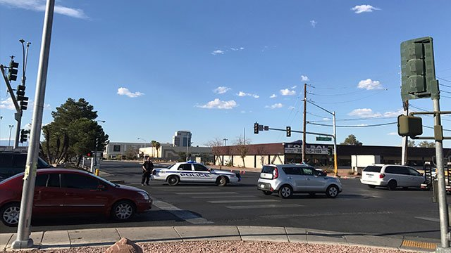 LVMPD squad cars close down the intersection of Arville and Tropicana after an officer-involved shooting (FOX5).