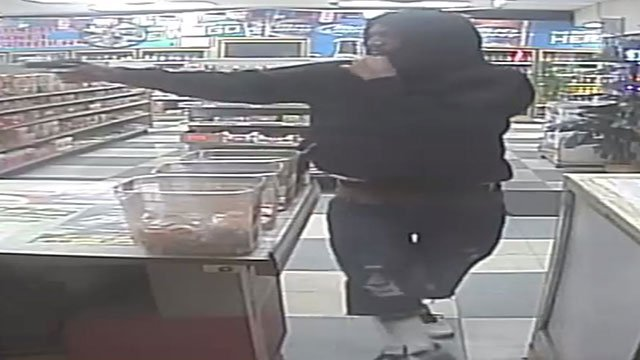 One suspect is shown brandishing his weapon at a store employee during a robbery on Aug. 2 (LVMPD / FOX5).