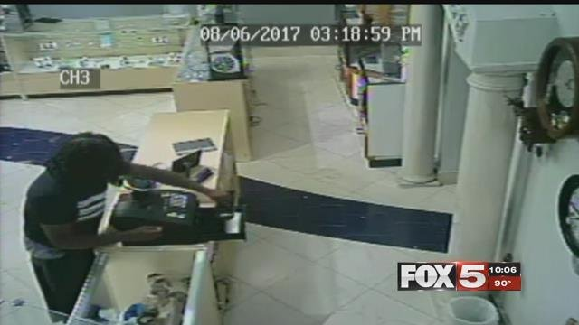 A thief reaches over the counter and steals hundreds of dollars from a jewelry store register (FOX5).