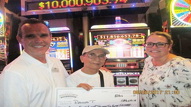 VP and GM of Fremont hotel-casino Jim Sullivan, jackpot winner Rodolfo T., and Slot Director Salinda Conklin. (Courtesy: Boyd Gaming)