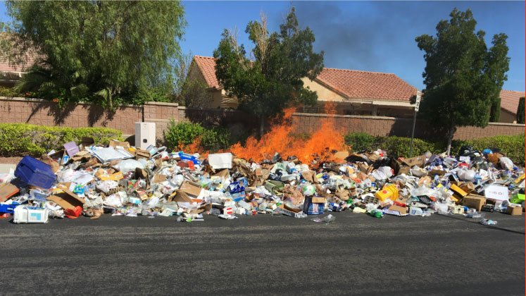 Flames burn through trash in a Valley neighborhood on Aug. 15, 2017. (Source: Don Wilkins)