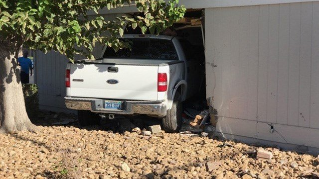 A truck crashed into an apartment on Mountain Vista near Flamingo. (Gai Phanalasy / FOX5)