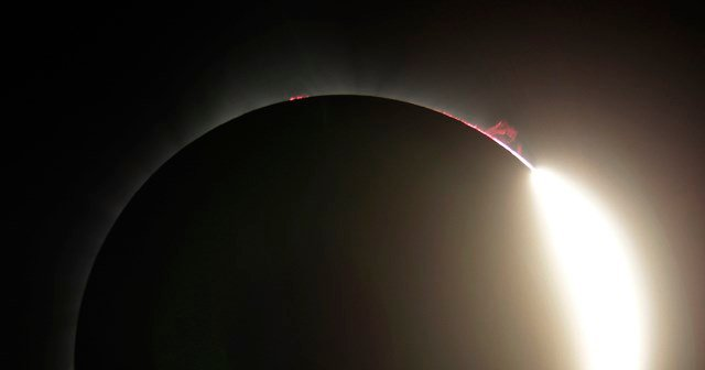 This photo shows solar flare as the sun emerges from a total eclipse by the moon Monday, Aug. 21, 2017, near Redmond, Ore.  (AP Photo/Ted S. Warren)