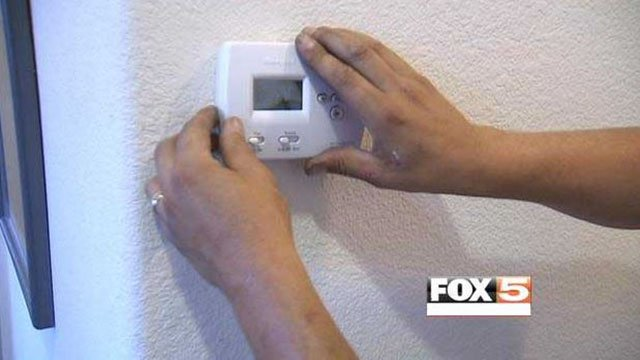 Repairman works on A/C unit inside a Las Vegas home in this undated image. (File/FOX5)