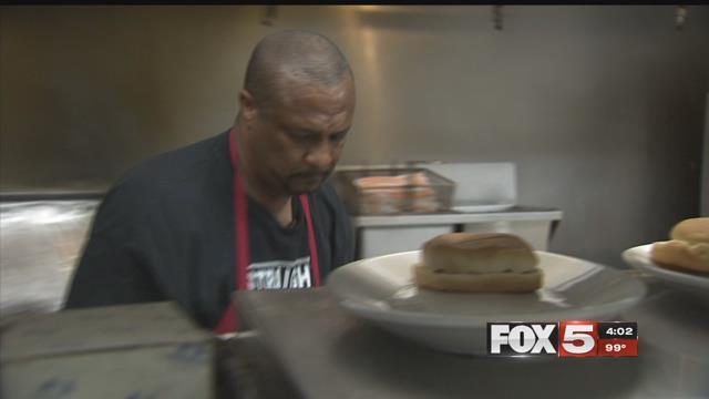 Sam Ealy diligently cooks at TC Rib Crib (FOX5).