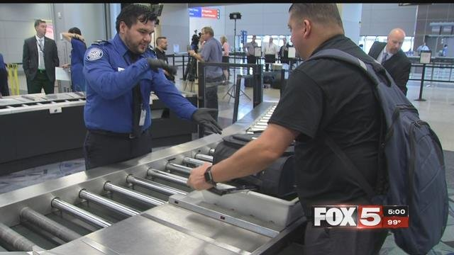 A passenger is preparing his luggage to go through the ASL screening process (FOX5).