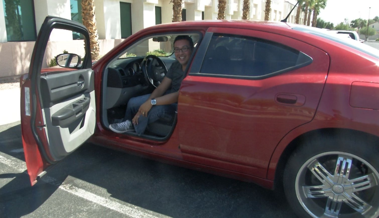 Former Las Vegas journalist Sergio Avila sits in his Dodge Charger. (Miguel Martinez-Valle/FOX5)