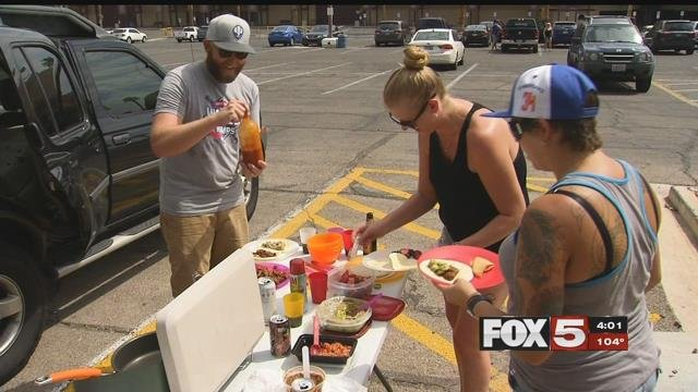 A family celebrates Labor Day with a cookout at Sunset Park (FOX5).