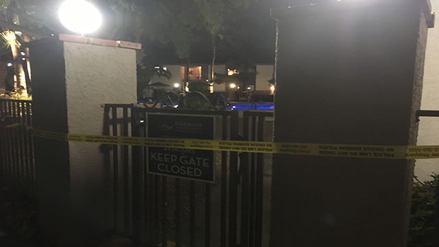 Police tape blocks the gate of an apartment complex pool where a man was found submerged in the water (FOX5).