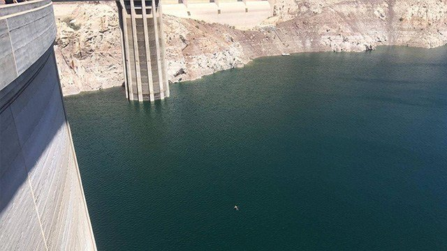 A man visiting Las Vegas from North Wales jumped into the Hoover Dam and successfully swam from the Arizona side to the Nevada side.