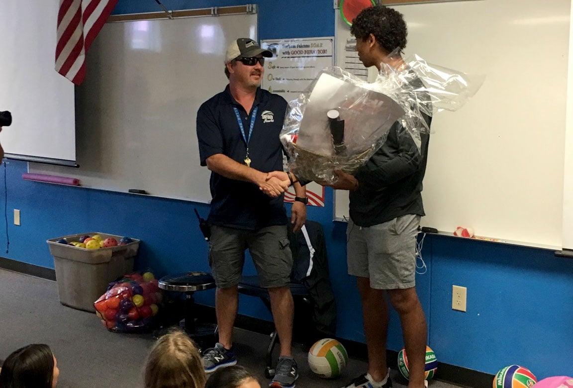 A UNLV Football player surprised a former teacher on Sept. 15, 2017. (Armando Navarro/FOX5)