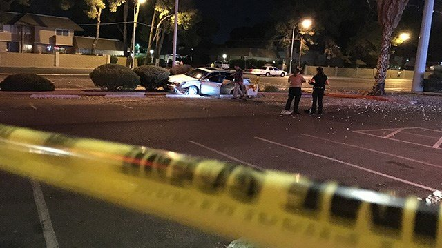 A woman died in a crash at Reno and Eastern Avenues.