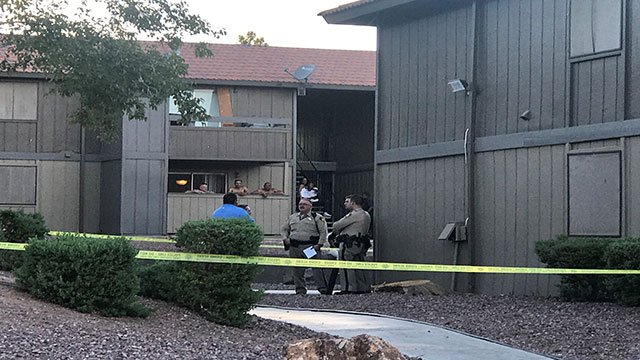 LVMPD officers speak with neighbors of the deceased at Solaire Apartments Sept. 12, 2017 (Gai Phanalasy / FOX5).