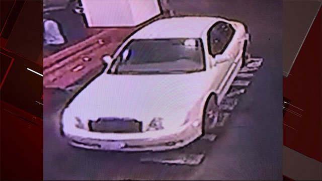 The armed suspects fled the scene in this white 4-door sedan (LVMPD).