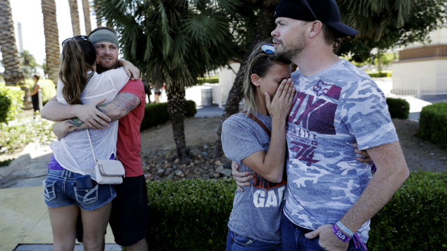 Two couples hug each other after a shooting on the Las Vegas Strip. (AP Photo/Marcio Jose Sanchez)