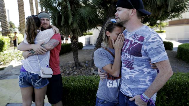 Two couples hug each other after a shooting on the Las Vegas Strip. (AP Photo/Marcio Jose Sanchez)