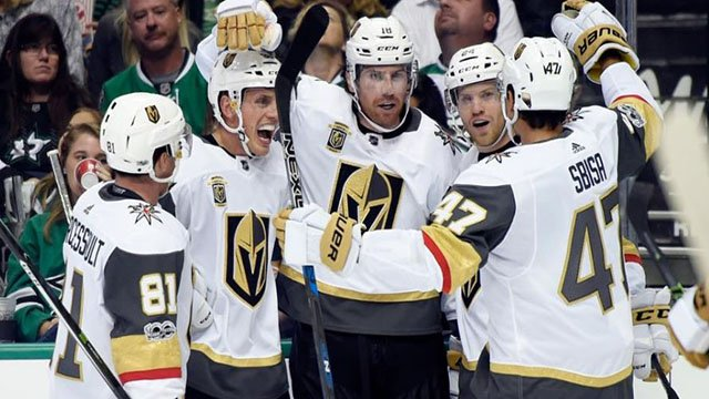 Golden Knights celebrate on the ice during inaugural season. (Craig Morgan/NHL)