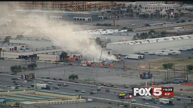 Firefighters put out a pipe fire on Desert Inn Road Monday.