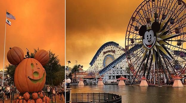A wildfire burning in California cast an eerie orange glow in the skies over Disneyland. (Brooke Nicole / Junior Olivas)