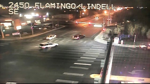 A LVMPD patrol vehicle blocks a lane while officers investigate a crash that killed a pedestrian (LVACS).