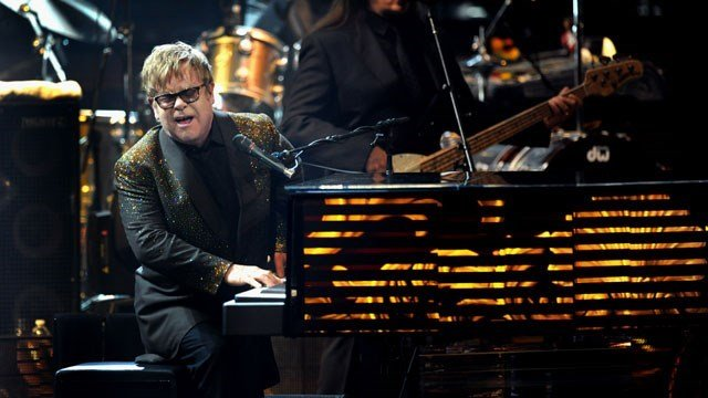"Elton John performs at The Colosseum at Caesars Palace on opening night of his new show, ""The Million Dollar Piano,"" Wednesday, Sept. 28, 2011 in Las Vegas. (AP Photo/Las Vegas News Bureau, Brian Jones)"