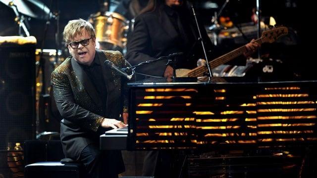 "Elton John performs at The Colosseum at Caesars Palace on opening night of his new show, ""The Million Dollar Piano,"" Wednesday, Sept. 28, 2011 in Las Vegas. (AP Photo/Las Vegas News Bureau, Brian Jones)"