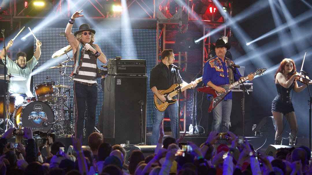 From left, Big Kenny and John Rich of Big and Rich at the CMT Ultimate KickOff Party at Kay Bailey Hutchison Convention Center on Friday, Jan. 9, 2015, in Dallas. (Photo by Ted Parker Jr./Invision/AP)