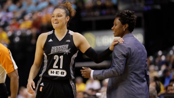 In this July 12, 2017, file photo, San Antonio Stars' Kayla McBride laughs with head coach Vickie Johnson during the second half of a WNBA basketball game against the Indiana Fever, in Indianapolis. (AP Photo/Darron Cummings, File)