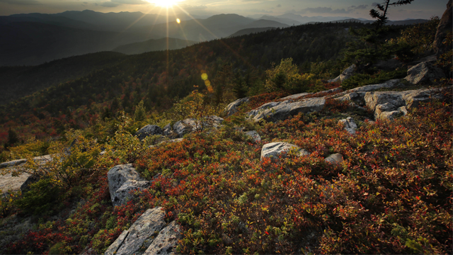 In this Wednesday, Sept. 27, 2017 photo the sun begins to set in this view from South Moat Mountain in Albany, N.H. (AP Photo/Robert F. Bukaty)