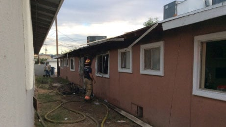 A firefighter looks at the damage caused by a fire on Oct. 30, 2017. (Source: LVFR)