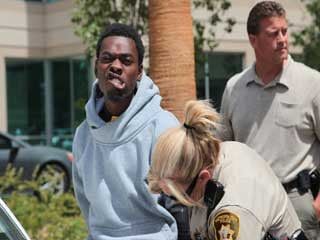 Bryan Clay, 22, poses for pictures as he is taken into custody. (Courtesy: LVMPD)