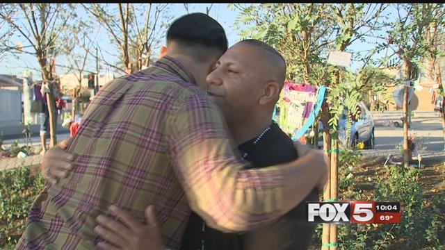 Ruben Mora embraces shooting survivor Shane Armstrong at downtown Las Vegas healing garden (FOX5).