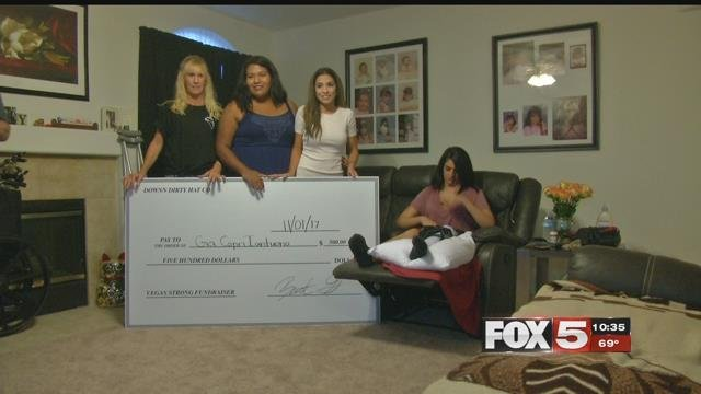 A check is presented to Gia Iantuono (FOX5).