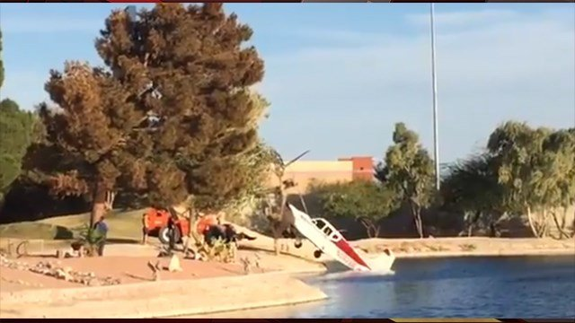 A small plane is pulled from a pond on a Las Vegas golf course where it made an emergency landing. Nov. 3, 2017 (Photo: Maggie Chung)