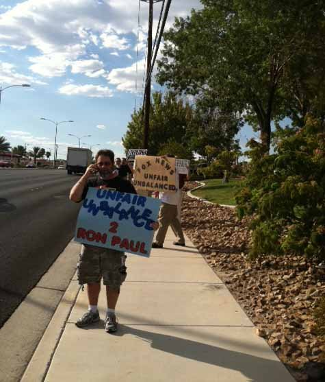 Ron Paul supporters protest outside the FOX5 studio