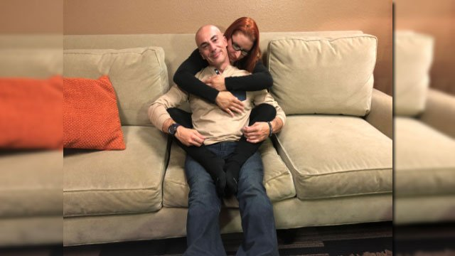 """Mike Doria and Kat demonstrate the """"fortune cookie"""" cuddling position. (Mike Doria/FOX5)"""