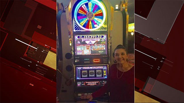 Millionaire Sylvia Tejeda poses with the lucky Wheel of Fortune slot machine Oct. 28, 2017 (Paris Las Vegas).