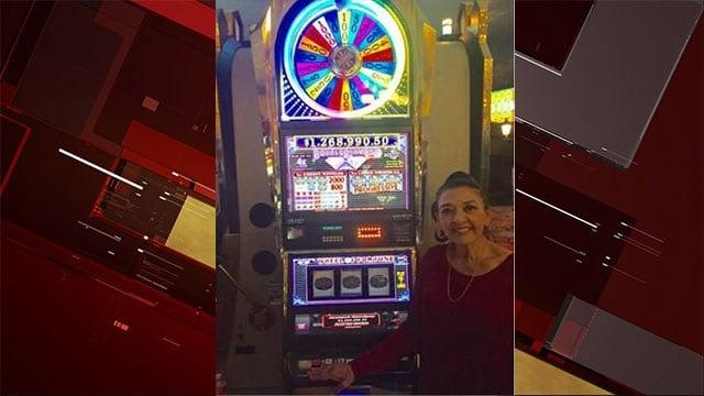 Millionaire Sylvia Tejeda poses with the lucky Wheel of Fortune slot machine Oct. 28, 2017 (Paris Las Vegas).