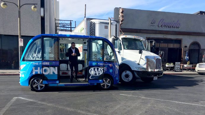 Electric shuttle bus returning to downtown Las Vegas roads