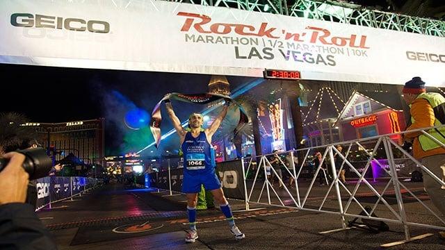 A runner celebrates at the finish line (LVCVA / Las Vegas News Bureau).