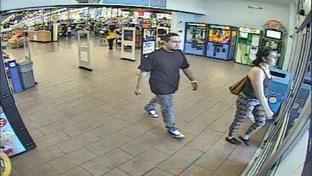 The two carjacking suspects are shown in this surveillance video still leaving a business after using stolen credit cards (LVMPD / FOX5).