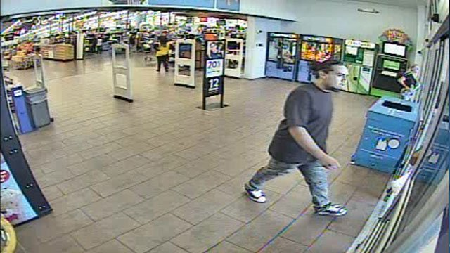 An armed suspect wanted for a carjacking is seen exiting a store (LVMPD / FOX5).