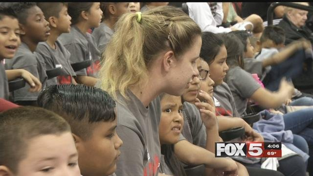 Excited students sit by their teacher during a UNLV Lady Rebels game (FOX5).