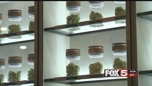 Marijuana strains sit on a shelf in an exhibitors booth at the Marijuana Business Convention (FOX5).
