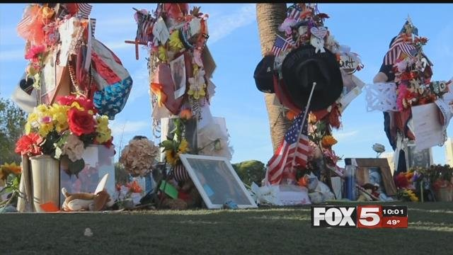 Photos, flowers and messages of hope were tacked on to 58 crosses on the Las Vegas Strip (FOX5).