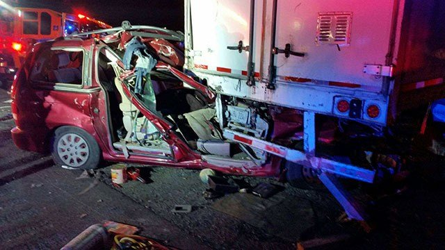 A van was pinned under a semi-trailer near the Valley of Fire Nov. 19, 2017 (NHP / FOX5).