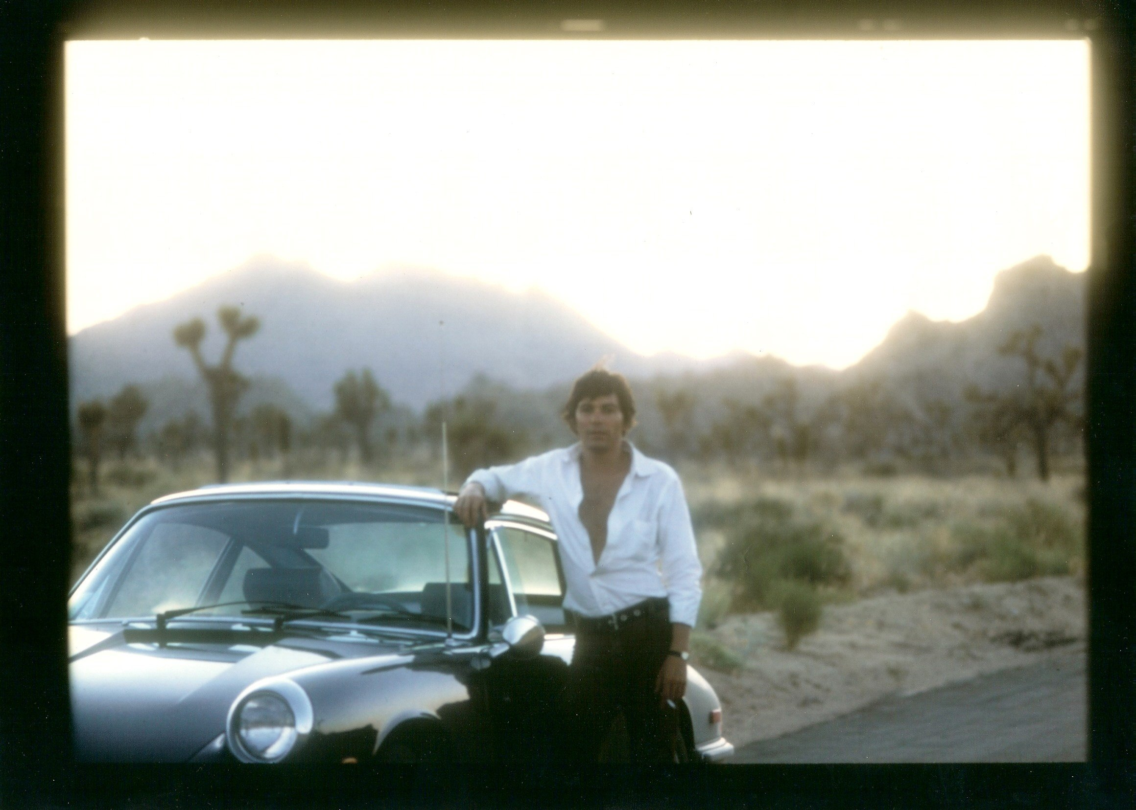 Jay Sebring posing with his Porsche.